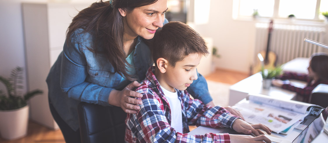 mother son learning online header of Best Foreign Language Online Homeschool Programs page