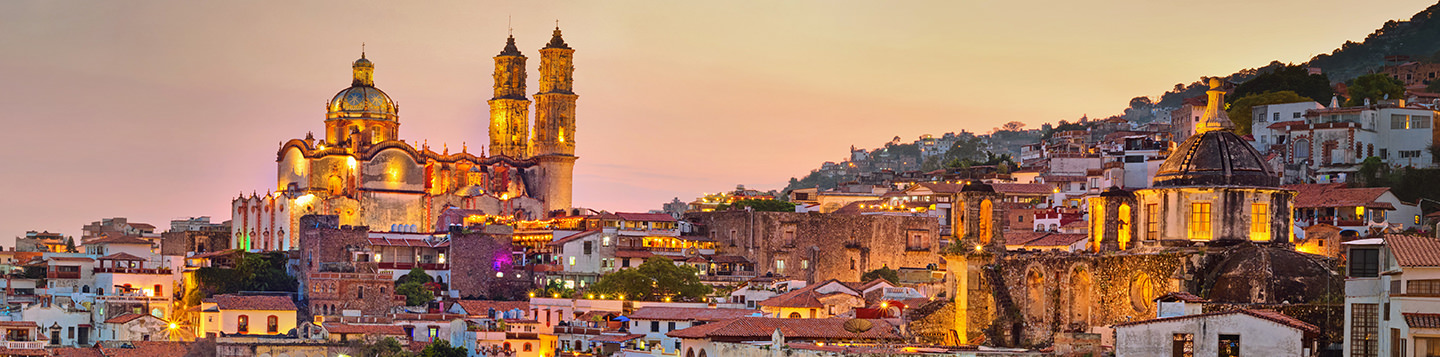 Learn Spanish with Rosetta Stone. Cityscape of old city at dusk.