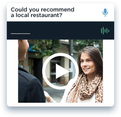 Lady on a street sidewalk asking a man for a restaurant recommendation