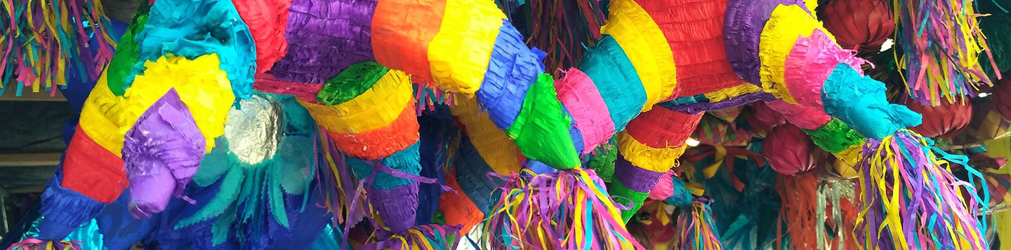Learn Spanish with Rosetta Stone. Various colorful piñatas.