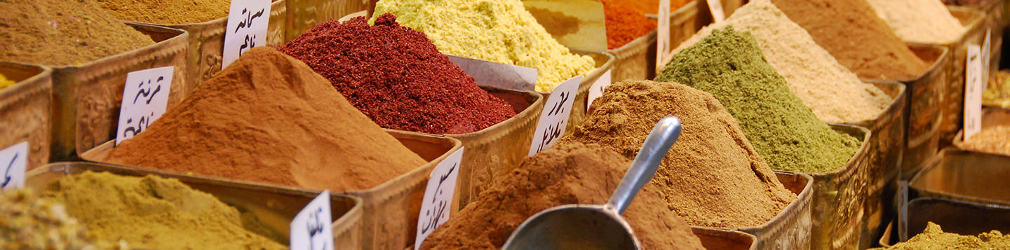Learn Arabic with Rosetta Stone. Various colorful spices in bins.
