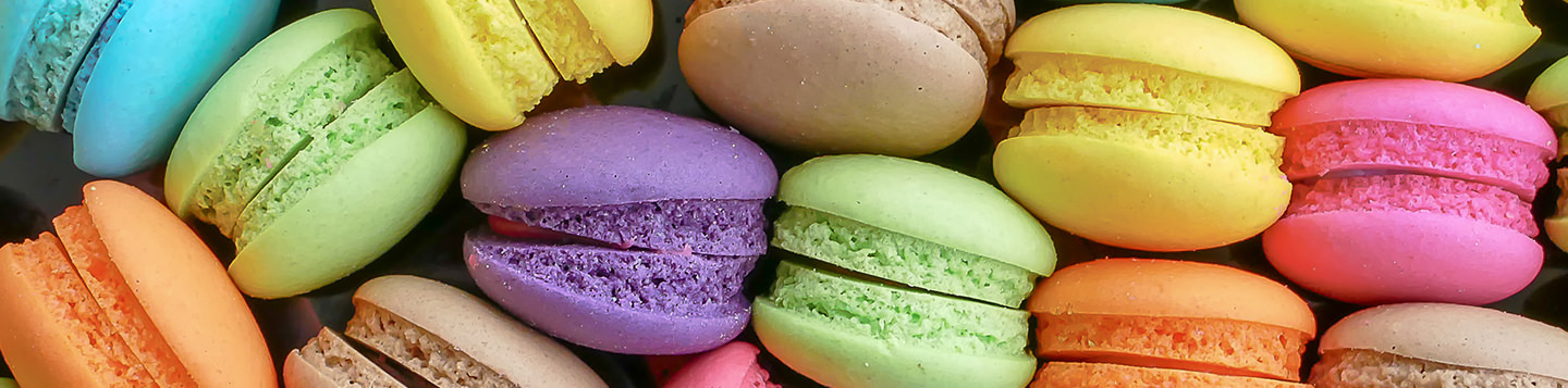 Learn French with Rosetta Stone. A close up of various colored macarons.