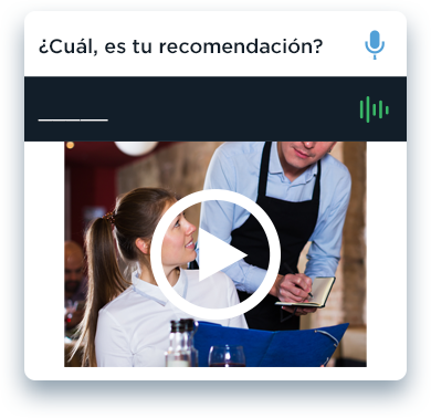 Learn Spanish with Rosetta Stone. Woman at a restaurant asks the waiter a question.