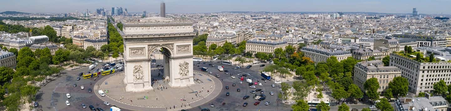 Arc de Triomphe Monument in Paris in France header of Rosetta Stone Regular Common French Verbs page