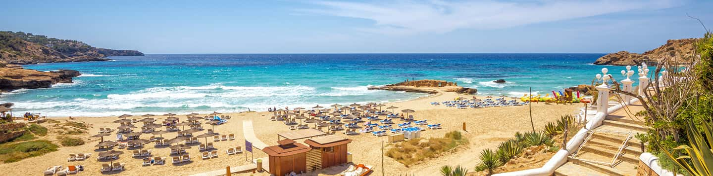 Spanish view of the beach header of Do you need help in Spanish page