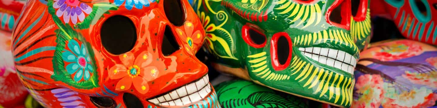 day of the dead red and green skulls best way to learn Spanish
