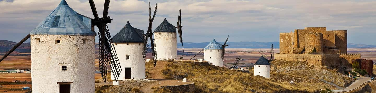 view of Spanish ruins and windmills on header of Spanish Words For To page