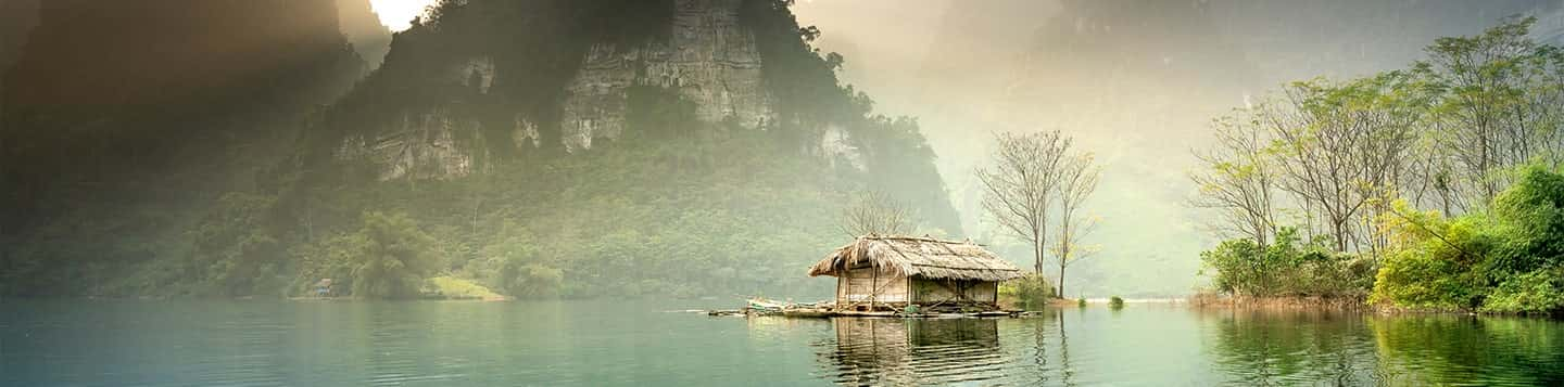 Vietnamese lake with house header of Rosetta Stone Vietnamese Language page