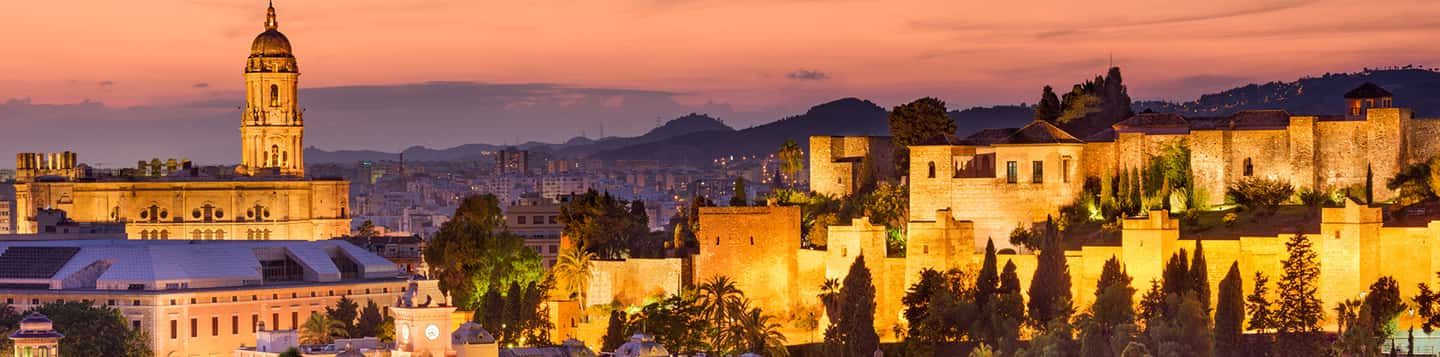 sunset of city of Málaga in Spain as header of How Do You Say Where Are You In Spanish page