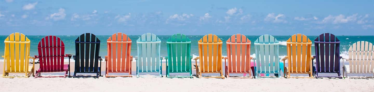 Colorful beach chairs on the beach header of Rosetta Stone Spanish Colors List page